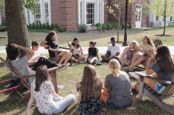 Students gathering outdoors on-campus