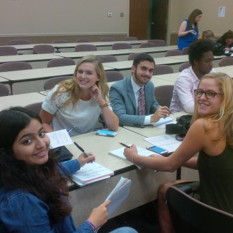 "The DePauw Debate Team prepares for the next round at the ""Forensic 500"" Tournament hosted by the University of Indianapolis. Pictured (left to right): Malak Daher, Jessica Miller, Adam Karadsheh, KeVeon White, Megan Ozog (2016)."