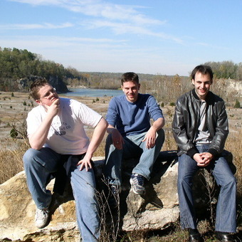 J.J. Burns contemplates great thoughts with the British National Debate Team at the DePauw Nature Park in 2005.