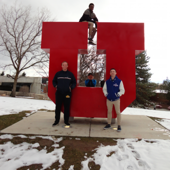 The DePauw Debate Team enjoys the refreshing mountain air at the 2019 NPDA National Tournament at the University of Utah. Bottom Row (left to right): Lucas Taylor, Yong Heo, Liam Byrnes. Top Row: KeVeon White.