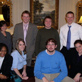 Brittney Belcher, Nikki Miyasato, Jessica Hawkins, Avery Archer, Aaron Dicker, Kevin Milne, Michael Lutz, and Keelin Kelly (left to right) are dressed for Success at the 2008 Pi Kappa Delta National tournament.