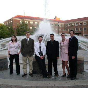 DePauw Debaters at the Fountain at Purdue University in 2005.  Left to right: Kalie Zamierowski, Michael Lutz, J.J. Burns, Projesh Banerjea, Jenny Starcevich, and Tyler Kennedy.