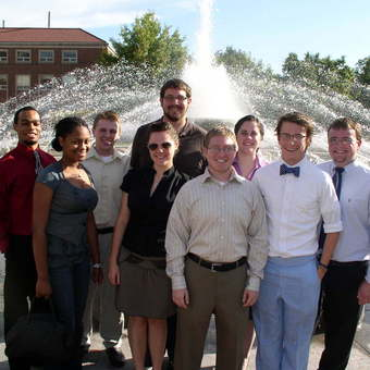"""DePauw Debaters enjoy the annual fountain ritual at the """"Boilermaker Special"""" tournament hosted by Purdue University. Left to Right: Robert Steele, Brittney Belcher, Avery Archer, Kevin Milne, Keelin Kelly, Aaron Dicker, Christine Walker, Tyler Hess, and Lucas Blauvelt (2009)."""