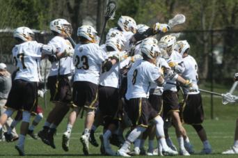 Lacrosse team celebrates a goal