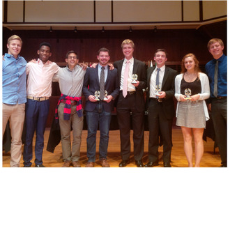 """The DePauw Debate Team at the 2015 """"Forensic 500"""" Tournament hosted by the University of Indianapolis.  Pictured (left to right): Matt Peirce, Kelechi Ikwuakor, Daniel Schultz, Matt Piggins, Mickey Terlep, Liam Byrnes, Jessica Miller, Jack Williams."""