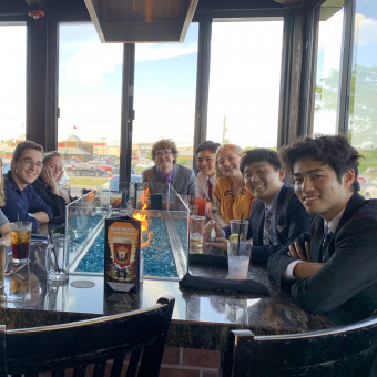 """The DePauw Debate team stays """"fired up"""" after the Forensic 500 tournament at the University of Indianapolis.  Right Side (front to back): Yasuaki Ono, Yong Heo, Alayna Trier, Yuki Harata, Alex Spencer (2019)."""