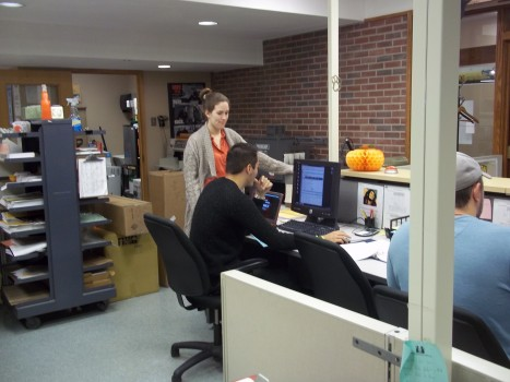 Students collaborating on a challenging help desk issue