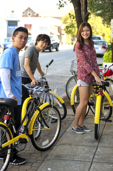 Students with bicycles on the square