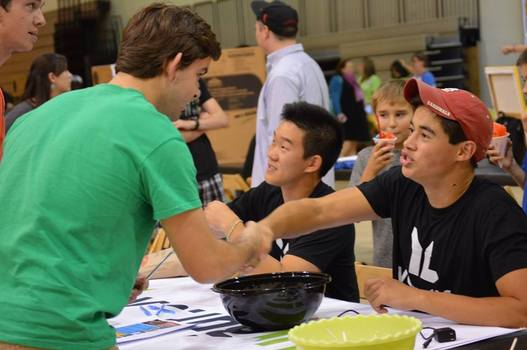 Students offering information during a community event