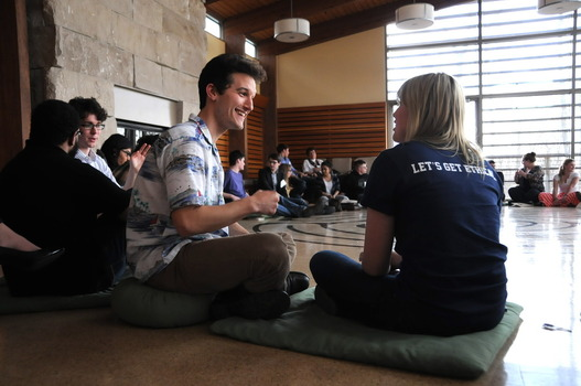 Zak Norton (University of Kentucky) and Prindle intern Noelle Witwer sitting on the floor during the opening ice-breaker session