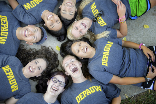 Students laughing in circle with DePauw shirts