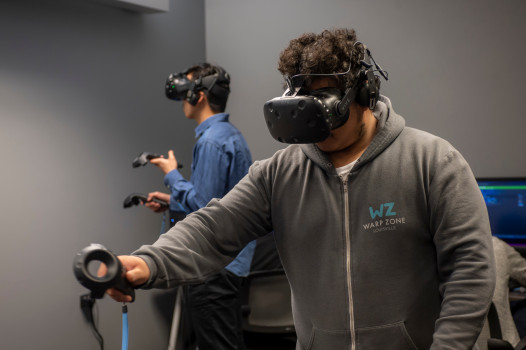 Two students using VR equipment in the Tenzer Visualization lab
