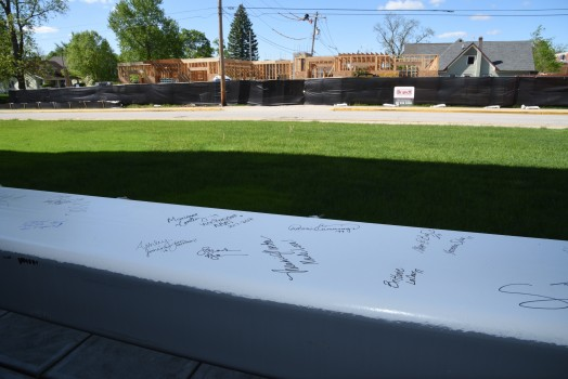 A beam for the new Center for Diversity and Inclusion is signed by community members.