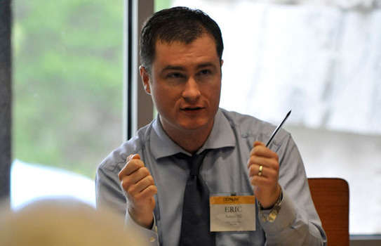 Eric Aasen speaking during a conference
