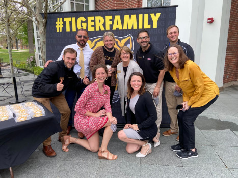 Admission team posing in front of a #TigerFamily banner
