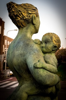 Statue of woman holding a child.