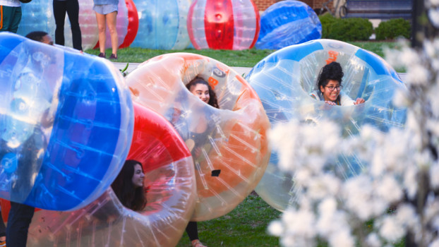Students competing in bubble soccer