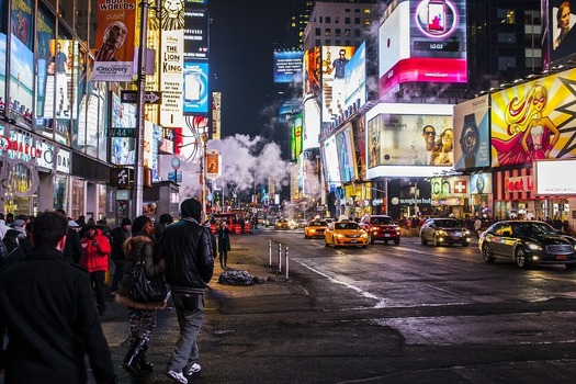 Times Square in New York City illuminated with billboards at nighttime.