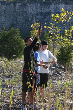 Conservation Biology students mapping invasive species in the DePauw Nature Park.