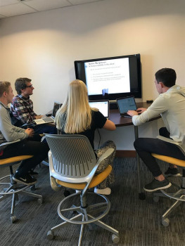 Members of the Consulting Group work on a project