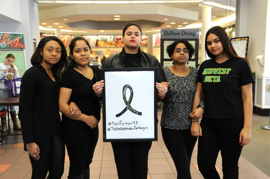 "(left to right) Students Amanda Volel, Natalie Yaipan, Greisy Genao, Penelope Ramirez, and Kimberly Mendez standing in solidarity with Ayotzinapa for Compton's ""Justice Thursdays""."