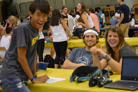 Students smiling during a community event