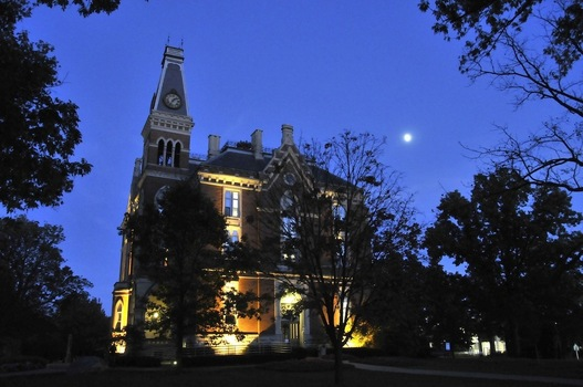 East College at night.