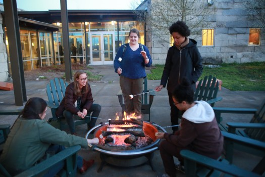 Students enjoying good conversation and s'mores in Prindle's courtyard (2017)