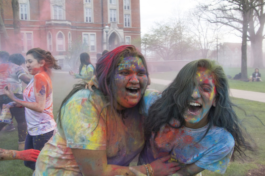 Interfaith Council Members Kainat Akmal '17 and ShelleyAnn Simon 17' celebrate the Hindu Holiday, Holi, on East College Lawn.