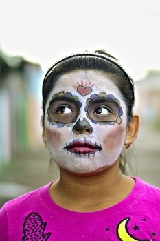 Woman with face paint of a skeleton for a Day of the Dead celebration.