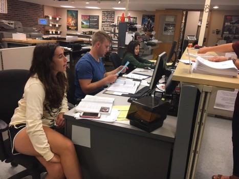 Students preparing customer orders at printing services