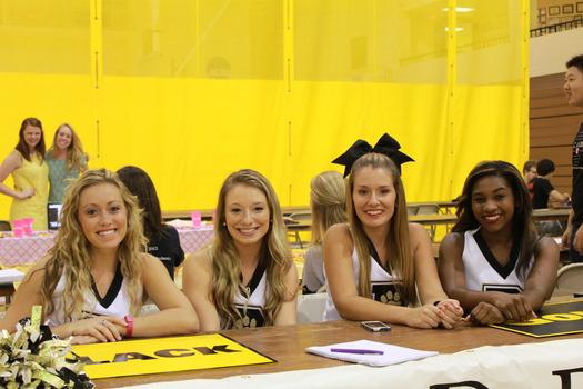 DePauw cheerleaders at community event