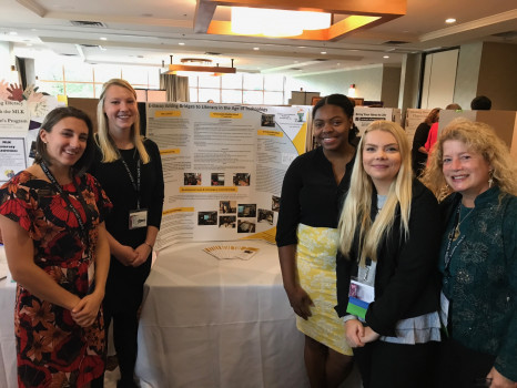 Kappa Delta Pi members Liz Gets, Brittany Buckner, Shanae Nelson, and Marta Malinowski, along with Counselor Dr. Jamie Stockton, present at the International Convocation in Pittsburgh, Pennsylvania in October 2017.
