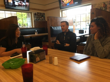 Students having lunch with one of our alumni, Mark Branigan '11, after the Technology Industry Insight panel.
