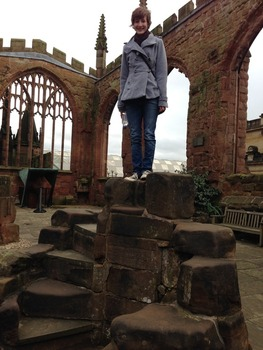 Eleanor stands in the ruined Coventry Cathedral