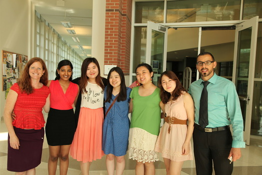 International Student Association 2013-2014 executive board members Prakruthi Suresh, Yue Ma, Mami Oyamada, Manmin Guo and Risa Kanai, with organization advisors Aliza Frame and Loutfi Jirari.
