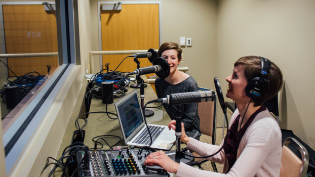 Examining Ethics podcast producers Eleanor Price and Christiane Wisehart in the recording booth