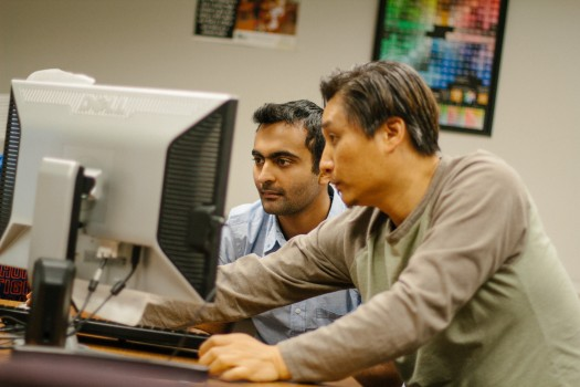 Jin Kim works with Shahraiz Niazi, Class of '19, during the Multimedia Rotation