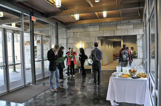 Students and visitors gather for an event at the entrance to the Institute