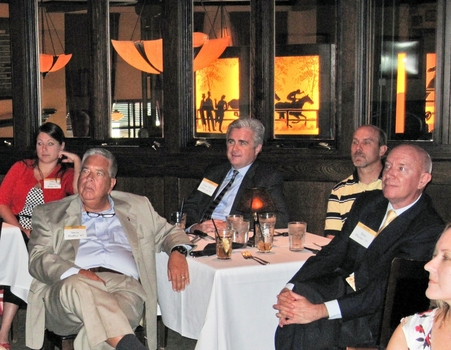 Indianapolis alumni listen intently to the speaker at a monthly networking lunch.