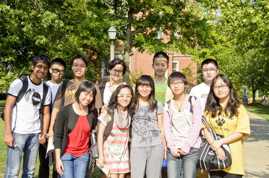 International student group posing on campus