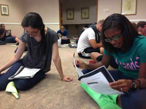 FYRA Yesenia Silva ('17) and CRA Ariel Cheatham ('16) participating in a reflection activity during SLS Institute
