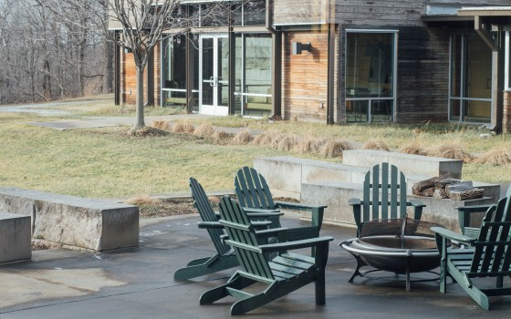 Photo of the courtyard with chairs, fireplace, and view of Prindle building by Son Le