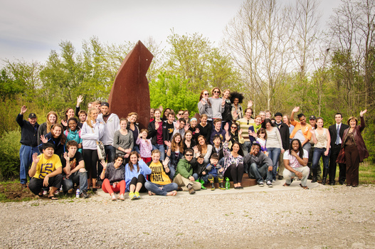 "DePauw students, faculty, and staff gather for the re-dedication of Mark Warwick's sculpture ""Reach"""