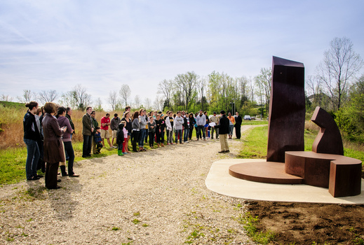 "Professor Michael Mackenzie presents during the re-dedication of Mark Warwick's sculpture ""Reach"""