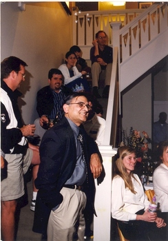 Faculty members lined up around a stairway at a gathering