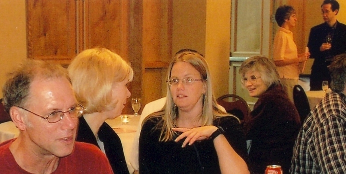 Faculty members sitting at a table during a meeting