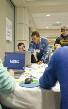 Greg Screws, Class of '13, assists Clark Wilson, Class of '15, at GIS Day