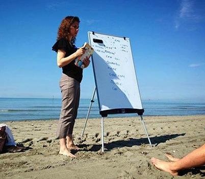 Professor Seaman teaching a lesson on the beach