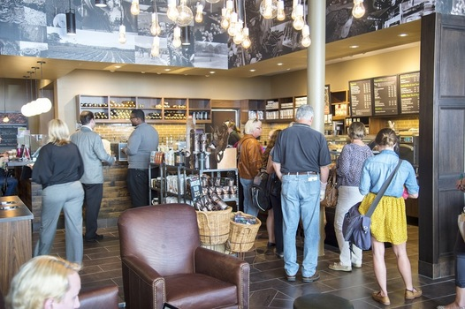 Patrons in line at the Starbucks at Eli's Books.